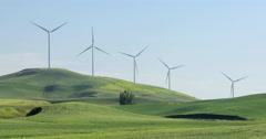 Wind turbine electric power generator in the field - stock footage