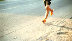 Marathon runner in the morning sun, healthy exercise concept, slow motion Stock Footage