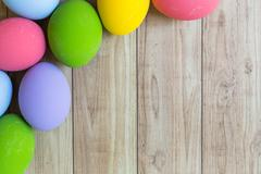 Colorful eggs on wood - stock photo