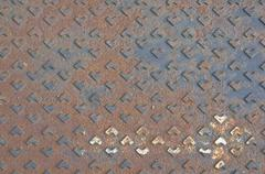 Rust metal cover of drain water as background or texture Stock Photos