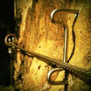 Rock climbing safety path via ferrata. Steel chrome anchors in rock Stock Photos