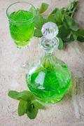 Green drink with soda - stock photo