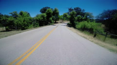Driving POV down Rural Country Road Arkistovideo