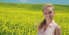 Young caucasian woman smile happy face in flower field - stock footage