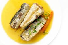 sardines in extra virgin olive oil and chilli on white - stock photo
