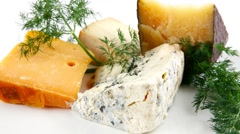 four type of delicatessen cheeses on plate - stock footage