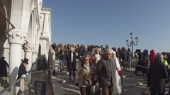 Venice, the Doge's Palace. People go to Piazza San Marco. Stock Footage