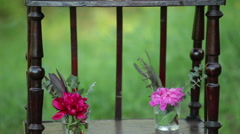 On the antique wooden stand tiny bouquets of roses and wedding cake Stock Footage