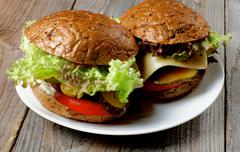 Homemade Hamburgers with Roasted Beef, Lettuce,Tomato, Onions, Cheese, Bacon and - stock photo