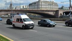 Ambulances with included special signals moves on the Kremlin embankment Stock Photos