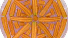Time-lapse of rotating and drying carrot, top view Stock Footage