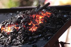 Glowing hot embers, closeup - stock photo