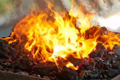 Flaming coals for the barbecue - stock photo