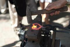 Process of forging metal products - stock photo