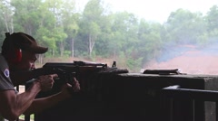 Man firing an AK-47 rifle at the Chi chu tunnel firing range Stock Footage