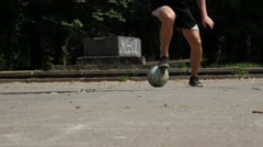 Close up of Young Man Demonstrating Footwork by Dribbling Soccer Ball Stock Footage