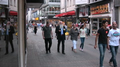 People walking along shopping street in Cologne - stock footage