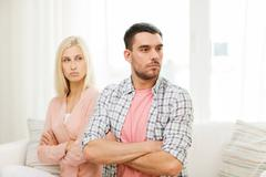 Stock Photo of unhappy couple having argument at home