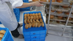 Baker Putting Hamburger Buns in Crate for Delivery Stock Footage