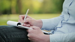Student Taking Notes in a Park Stock Footage