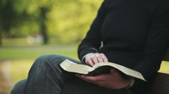 Bible Reading - Devotional in a Park Stock Footage