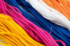 Several strands of colored cotton Stock Photos