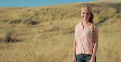 Young caucasian woman in desert field smile happy face Stock Footage