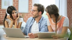 Group of friends listening to music on internet Stock Footage