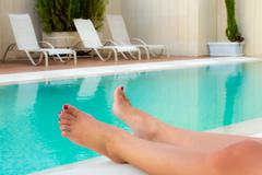 tanned woman's legs - stock photo