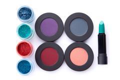Set of loose and pressed eyeshadows, and lipstick Kuvituskuvat