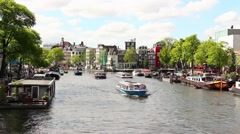 Canals of Amsterdam with line of boats, Netherlands - stock footage