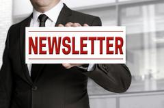 Stock Photo of Newsletter sign held by businessman.