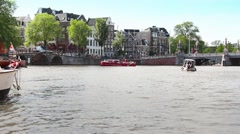 Sailing in the canals of Amsterdam, Netherlands - stock footage