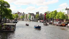 Beautiful day in the Canals of Amsterdam, Netherlands - stock footage