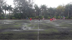 People playing football match in heavy raining day Stock Footage
