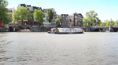 Canals of Amsterdam famous houses in Netherlands - stock footage