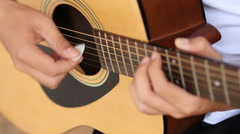 hand playing acoustic guitar - stock footage