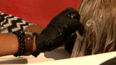 Hairdresser washing hair Stock Footage