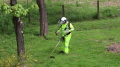 Gardener Man Cut Grass With Trimmer Stock Footage