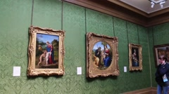 Visitors Are Watching Paintings In The Art Gallery - stock footage