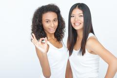 Smiling girls bonding to each other - stock photo
