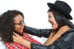 Positive friend holding necks of each other - stock photo