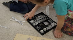 Children Playing with Model Construction Toys Stock Footage