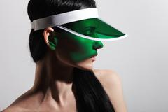 Studio shoot of a woman wearing plastic visor cap Stock Photos