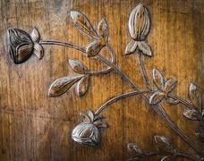 Leaves and flowers carved in the wood Stock Photos