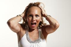 screaming senior woman. Sceared, screaming, fear, - stock photo
