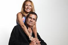happy senior couple on a white background - stock photo