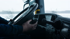 Truck driver starts to move in the snow Stock Footage