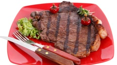 New york style meat beef steak on red plate Stock Footage