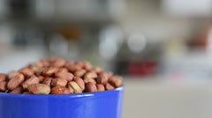 Many peanuts on the plate, which is spinning. Stock Footage